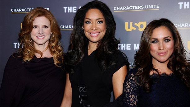 """Meghan Markle (left) posing with her co-stars from USA Network's hit legal drama """"Suits."""""""