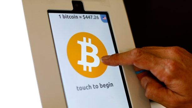 File photo. A bitcoin ATM machine is shown at a restaurant in San Diego, California.