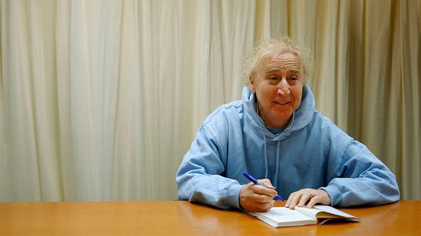 """Actor and author Gene Wilder poses as he autographs his new book """"The Woman Who Wouldn't"""" during a book signing session in New York March 26, 2008."""