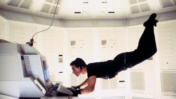 "Actor Tom Cruise is shown as he portrays ""Agent Ethan Hunt"" in the adventure thriller film, ""Mission Impossible."""