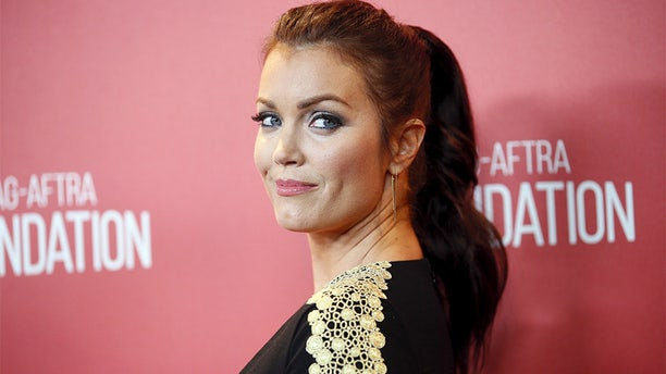 """""""Scandal"""" actress Bellamy Young said the veteran host should """"step aside."""" from his Oscars gig."""