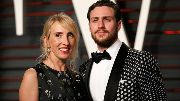 Director Sam Taylor-Johnson and husband, Aaron Taylor-Johnson, arrive at the Vanity Fair Oscar Party in Beverly Hills, California February 28, 2016.