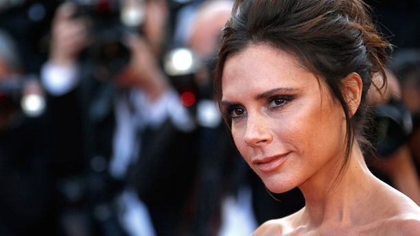 """Victoria Beckham poses on the red carpet as she arrives for the opening ceremony and the screening of the film """"Cafe Society"""" out of competition during the 69th Cannes Film Festival in Cannes, France."""