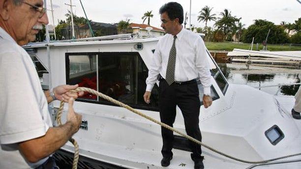 Ramon Saul Sanchez, in a white shirt, in a 2006 file photo.