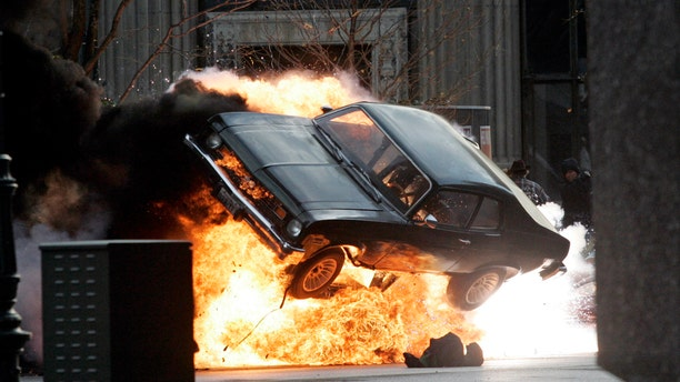 "A car blows up on the set of ""Red Dawn"" in Detroit, Michigan, October 19, 2009. (REUTERS/Rebecca Cook)"