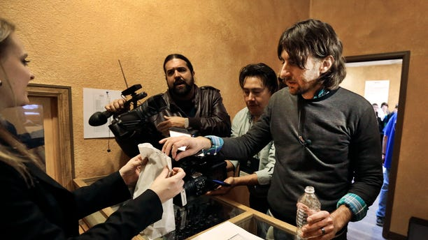 Adam Hartle is one of the first to buy marijuana at a legal recreational retail outlet in Denver, on Jan. 1, 2014.