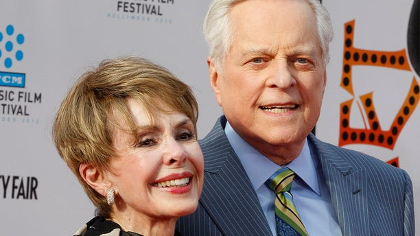 "Actress Barbara Rush (L) arrives with TCM host Robert Osborne at the world premiere of the 40th anniversary restoration of the film ""Cabaret"" during the opening night gala of the 2012 TCM Classic Film Festival in Hollywood, California April 12, 2012."