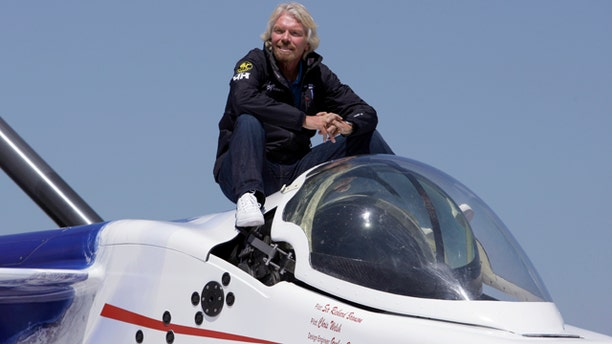 April 5: Billionaire adventurer Richard Branson poses aboard the Virgin Oceanic Expeditions deep sea submarine, in which Branson, Welsh and others plan to take solo piloted expeditions to the deepest point in each of the world's five oceans, at a news conference in Newport Beach, Calif.