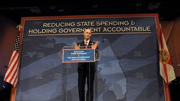 FILE: Florida Gov. Rick Scott announces his new budget during a Tea Party event in Eustis, Fla., on Feb. 7.