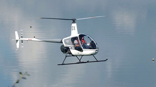 AUCKLAND, NEW ZEALAND - APRIL 17:  A Robinson R22 helicopter does a test flight around Catalina Bay on Auckland's Waitemata Harbour, Wednesday.  (Photo by Dean Purcell/Getty Images)
