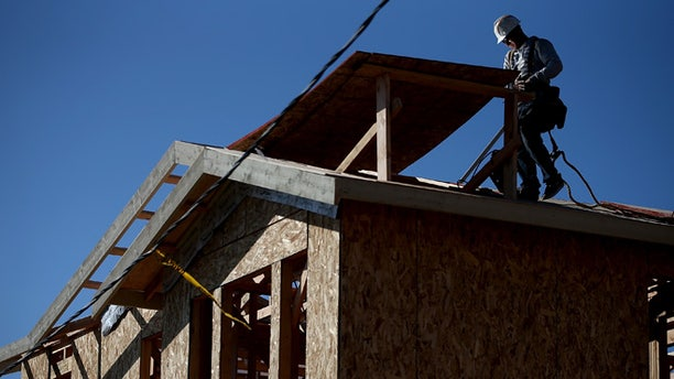 PETALUMA, CA - JANUARY 21:  A worker walks on a roof as he builds a new home on January 21, 2015 in Petaluma, California. According to a Commerce Department report, construction of new homes increased 4.4 percent in December, pushing building of new homes to the highest level in nine years.  (Photo by Justin Sullivan/Getty Images)