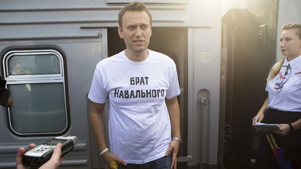 """July 17, 2013: Russian opposition activist Alexei Navalny, wearing a T-shirt reading """"Navalny's Brother"""" speaks to supporters and the media at the Yaroslavsky railway terminal in Moscow. (AP Photo/Alexander Zemlianichenko Jr)"""