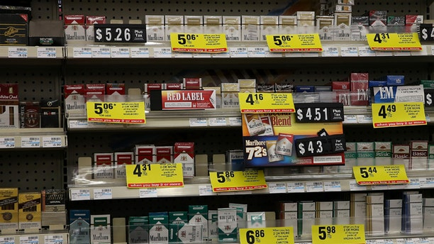 GREENBRAE, CA - FEBRUARY 06:  Packs of cigarettes are displayed on a shelf at a CVS store on February 6, 2014 in Greenbrae, California. CVS Caremark announced Wednesday that it will no longer sell cigarettes or other tobacco products as of October 1, 2014 at its CVS/pharmacy stores. (Photo by Justin Sullivan/Getty Images)