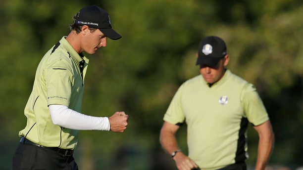 Europe's Nicolas Colsaerts reacts after making a birdie on the 15th hole during a four-ball match at the Ryder Cup PGA golf tournament Friday, Sept. 28, 2012, at the Medinah Country Club in Medinah, Ill. (AP Photo/Chris Carlson)