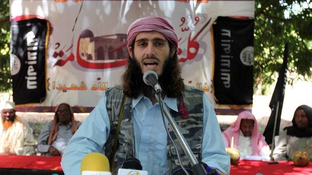 FILE 2011: American-born Islamist militant fighter, Omar Hamami, known as Abu Mansur Al-Amriki, addresses a news conference at a farm in southern Mogadishu's Afgoye district.