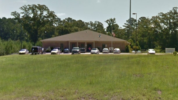 Branen Carter, 21, stabbed his mother and grandmother in the Social Security office in McComb, Miss., Monday, and was then shot to death by a security guard, officials said.  (Facebook)