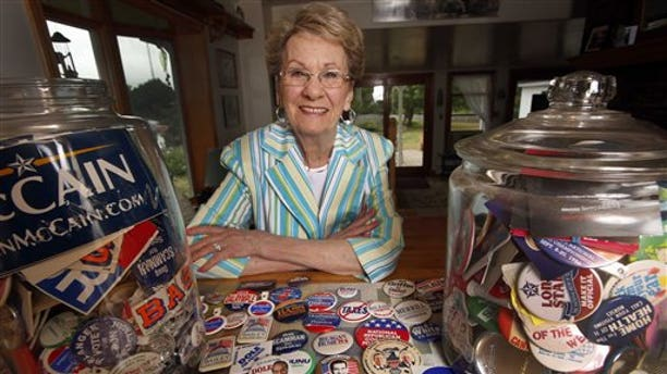 Judy Galluzzo poses with campaign buttons shes collected over the years, Friday, Aug. 21, 2015,  in Salem, N.H. Few volunteers know the Republican stronghold of Salem better than Galluzzo, whose first race in the 1970s was an early campaign of former Gov. John H. Sununu. Shes been active ever since, running campaigns on a volunteer basis for the local register of deeds, the county attorney and many more. (AP Photo/Jim Cole)