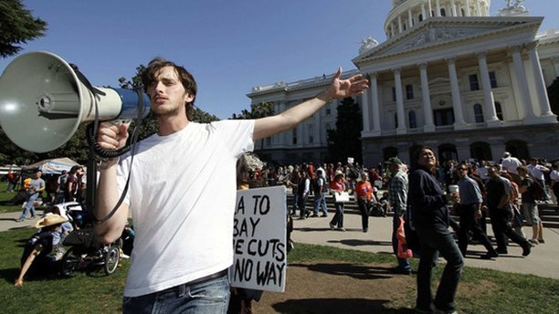 FILE: A Santa Monica College student calls to fellow protesters as they gather in Sacramento to demand higher funding for education.