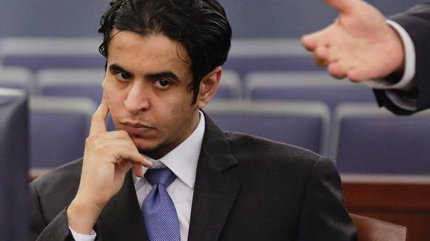 FILE - In this Wednesday, Oct. 23, 2013, file photo, Defendant Mazen Alotaibi, listens to comments by his defense attorney, Don Chairez during the jury selection process for his trial at Justice Court in Las Vegas.  Sentencing is scheduled Wednesday, Jan. 28, 2015 for Alotaibi, a 25-year-old Saudi Arabian air force sergeant who was found guilty of kidnapping and sexually assaulting a 13-year-old boy at a Las Vegas Strip hotel on New Year's Eve 2012. (AP Photo/Julie Jacobson, File)