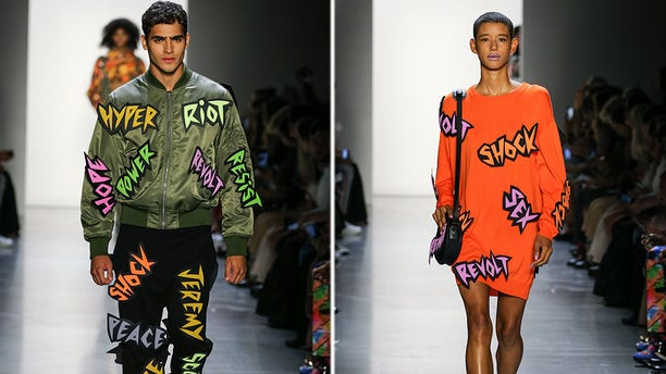Two models walk the runway wearing Jeremy Scott Spring 2019 at Gallery I at Spring Studios on September 6, 2018 in New York City.