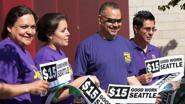FILE: June 2, 2014: Labor activists at minimum-wage rally at City Hall, Seattle, Washington.