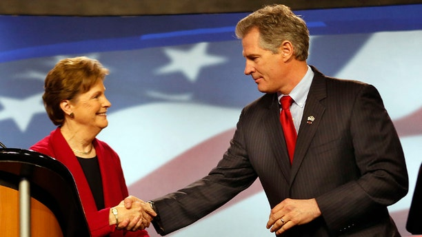 In this Thursday, Oct., 2014 photo, Democrat, U.S. Sen Jeanne Shaheen, left, shakes hands with her Republican opponent former Massachusetts U.S. Sen. Scott Brown before a live televised debate for U.S. Senate.