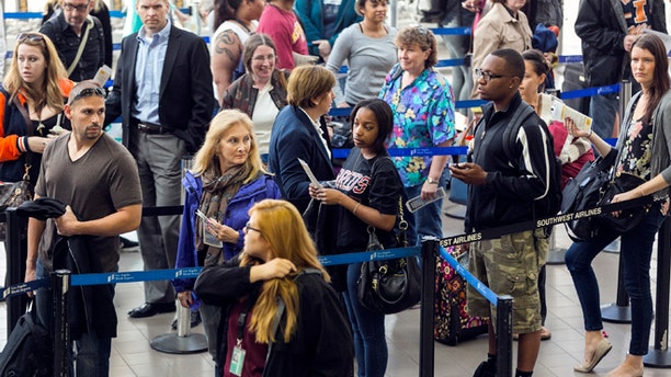 April 22: Travelers stand in line at Los Angeles International airport in Los Angeles.