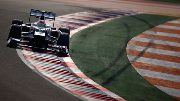 NOIDA, INDIA - OCTOBER 27:  Sergio Perez of Mexico and Sauber F1 drives during qualifying for the Indian Formula One Grand Prix at Buddh International Circuit on October 27, 2012 in Noida, India.  (Photo by Clive Mason/Getty Images)