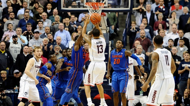 Napier goes up for the game winning basket at the buzzer on Monday, Dec. 2, 2013, in Storrs, Conn.