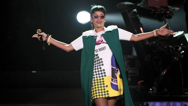September 22, 2013: Rihanna performs Sunday on the sidelines of the Formula One Singapore Grand Prix race weekend in Singapore.(AP Photo)