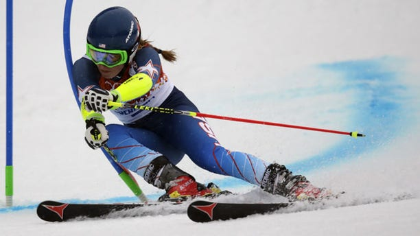 February 18, 2014: United States' Mikaela Shiffrin passes a gate in the first run of the women's giant slalom at the Sochi 2014 Winter Olympics in Krasnaya Polyana, Russia. (AP Photo/Charles Krupa)
