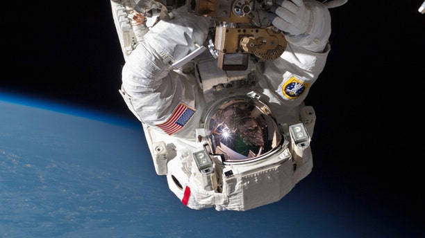 Astronaut Chris Cassidy performs a space walk to inspect and replace a pump controller box on the International Space Station after an ammonia coolant leak was discovered in May, 2013.