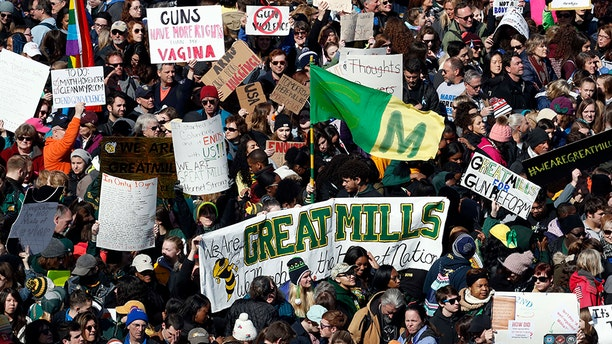 """A sign from Maryland's Great Mills High School is seen in the crowd during the """"March for Our Lives"""" rally in support of gun control, Saturday, March 24, 2018, in Washington."""