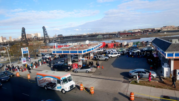 Nov. 2, 2012: People and vehicles line up at a gas station waiting to fill up in Newark, N.J.