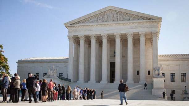 In this Monday, Oct. 6, 2014 photo, people wait to enter the Supreme Court in Washington as it begins its new term.