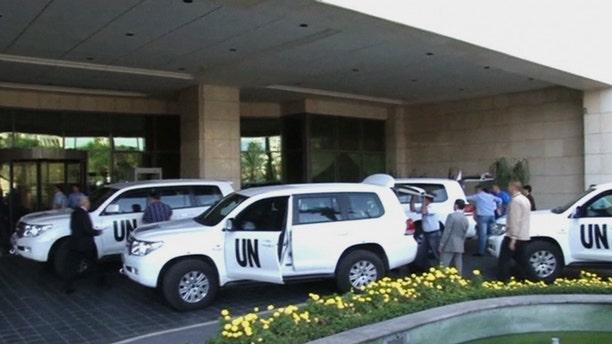 Aug. 18, 2013 - In this image made from video, U.N. weapon inspectors arrive at a hotel in Damascus, Syria for a long-delayed mission to investigate the alleged use of chemical arms in Syria's civil war.