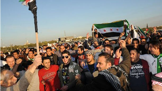 Feb. 4, 2012: Kuwaiti citizens and Syrians resident  in Kuwait protest in front of the Syrian Embassy in Mishref, Kuwait City.