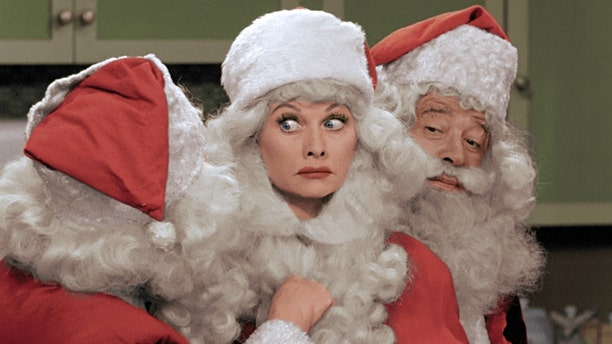 """This image released by CBS shows Lucille Ball, center, dressed as Santa Claus in a colorized """"I Love Lucy Christmas Special."""" (AP Photo/CBS)"""