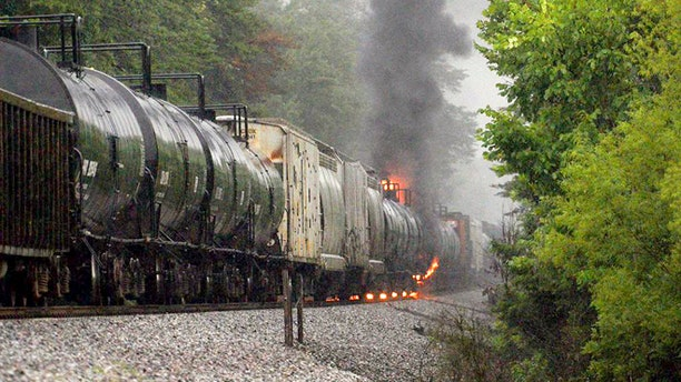 July 2, 2015: Smoke rises from a CSX train carrying flammable and toxic gas in Maryville, Tenn.