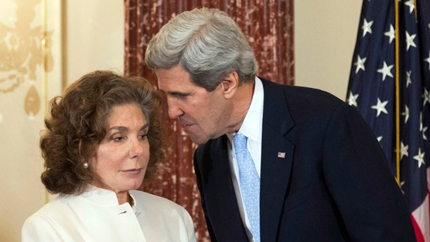 Feb. 6, 2013: In this file photo, Secretary of State John Kerry, right, whispers to his wife Teresa Heinz Kerry during the ceremonial swearing-in for him as the 68th secretary of state, at the State Department in Washington.