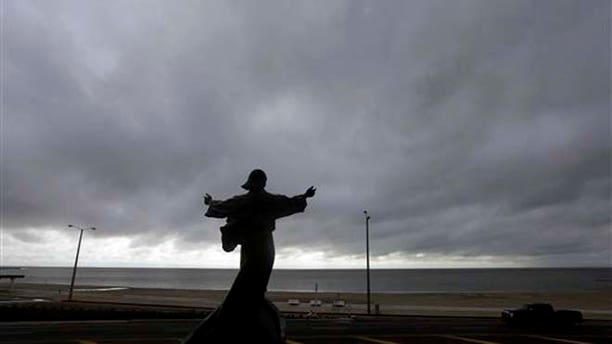 """A statue of Jesus calming the sea titled """"It is I"""" faces the bay and gulf, in Corpus Christi, Tuesday, June 16, 2015, as Tropical Storm Bill begins to make landfall. The National Hurricane Center in Miami says Tropical Storm Bill came ashore Tuesday morning in the area of Matagorda County, about 90 miles southwest of Houston.  (AP Photo/Eric Gay)"""