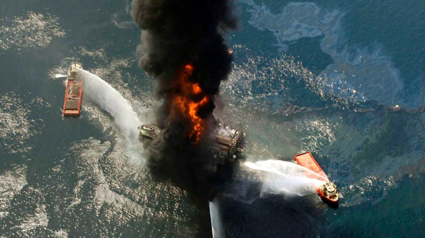 This April 21, 2010, file photo shows the Deepwater Horizon oil rig burning after an explosion in the Gulf of Mexico, off the southeast tip of Louisiana. A new study from the presidential oil spill commission describes the behind-the-scenes, excruiating tension and mistakes behind the three-month effort to cap the busted well.
