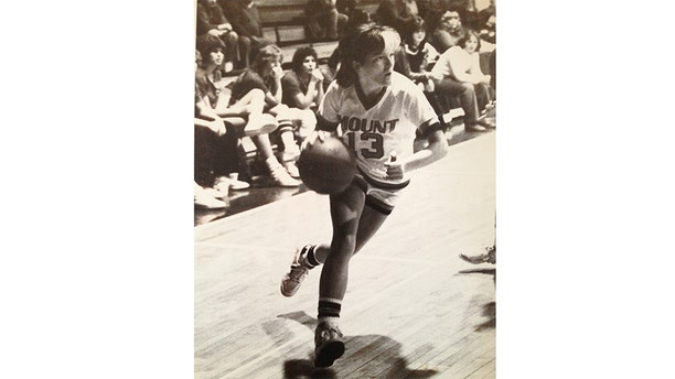 Tina Alexis Allen playing basketball.