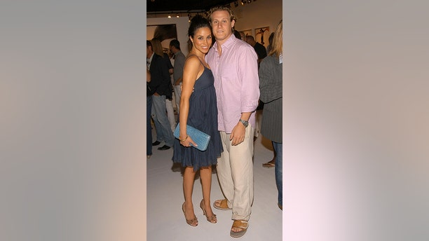 Meghan Markle and Trevor Engelson attend COACH Legacy Photo Exhibit by REED KRAKOFF at Coach on August 26, 2006 in East Hampton, NY.