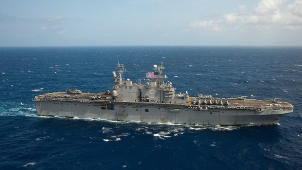 FILE: This photo shows the USS Peleliu, which the Navy diverted to assist in the search for a missing 35-year-old British man.