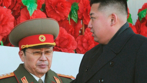 FILE: North Korean leader Kim Jong Un is flanked by his uncle Jang Song Thaek at a military parade to mark the birth anniversary of the North's late leader Kim Jong-il in Pyongyang.