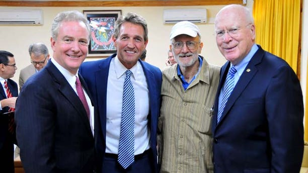 This Wednesday, Dec. 17, 2014 photo shows Alan Gross, second from right, with, from left, Rep. Chris Van Hollen, D-Md., Sen. Jeff Flake, R-Ariz., and Sen. Patrick Leahy, D-Vt. in Havana, Cuba.