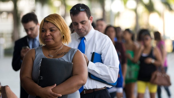 In this Jan. 15, 2013, photo, Racheel Weston, stood in line with a few hundred other job seekers, during a job fair in Miami.  (AP Photo/J Pat Carter)