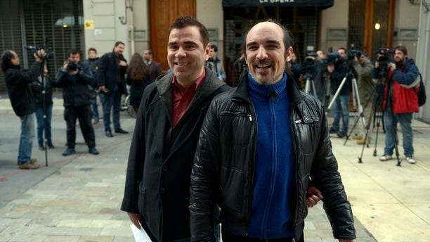 Rodrigo Borda and his partner Sergio Miranda leave the Civil Registry office where they signed up to marry in Montevideo, Uruguay, Monday, Aug. 5, 2013.