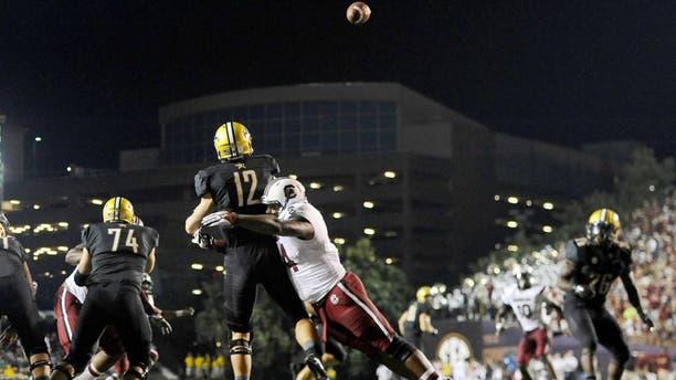 Sep 20, 2014; Nashville, TN, USA; Vanderbilt Commodores quarterback Wade Freebeck (12) is hit as he passes the ball during the first half against the South Carolina Gamecocks at Vanderbilt Stadium. Mandatory Credit: Christopher Hanewinckel-USA TODAY Sports